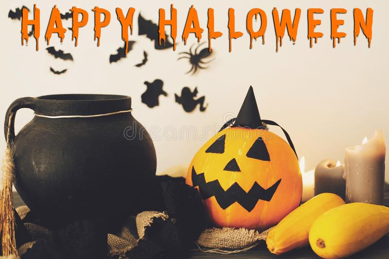 Happy Halloween text concept. Seasons greeting, spooky Halloween. Sign. Witch cauldron, Jack o lantern, pumpkin,candles, broom and bats, ghosts on background stock photos