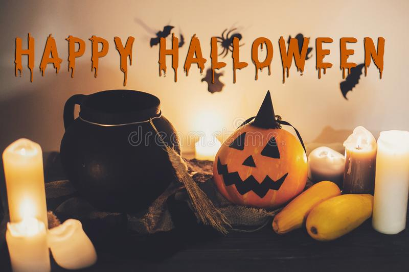 Happy Halloween text concept. Seasons greeting, spooky Halloween. Sign. Witch cauldron, Jack o lantern, pumpkin,candles, broom and bats, ghosts in night stock image