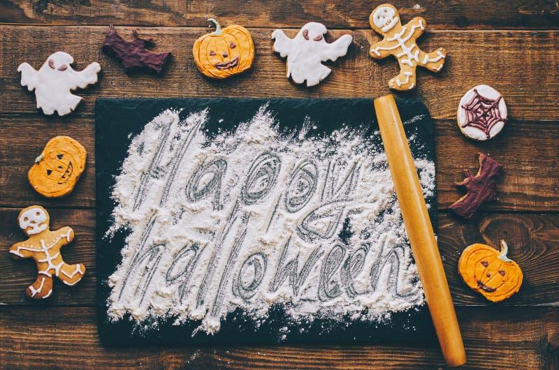 Happy Halloween Text. Flour text happy halloween on wooden kitchen desk stock images