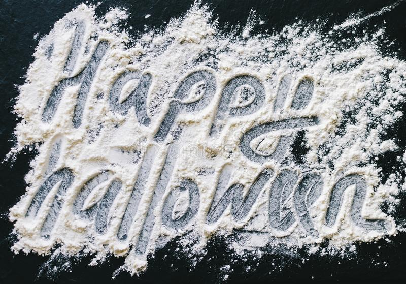 Happy Halloween Text. Flour text happy halloween on wooden kitchen desk royalty free stock images