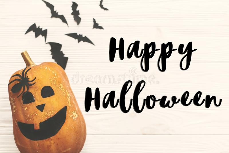 Happy Halloween text sign, flat lay. Halloween pumpkin Jack o La stock photo