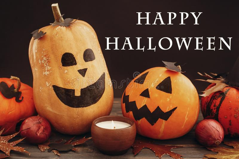 Happy Halloween text sign on pumpkins, jack-o-lantern, witch cauldron,bats, spider, candle,ghost, autumn leaves on dark. Background. Space for text. Halloween royalty free stock photos