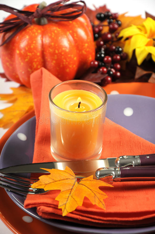 Happy Halloween or Thanksgiving party table place setting closeup. Happy Halloween or Thanksgiving party table place setting with Autumn Fall leaves, pumpkin stock images