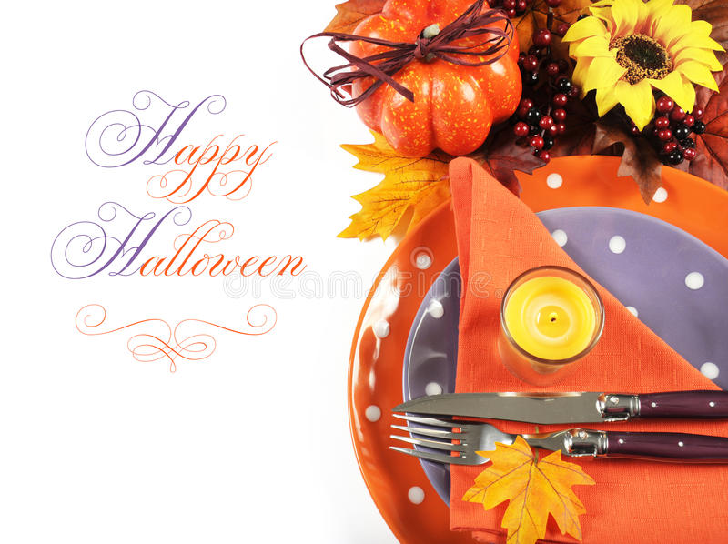 Happy Halloween or Thanksgiving party table place setting with sample text. Happy Halloween or Thanksgiving party table place setting with Autumn Fall leaves stock photo
