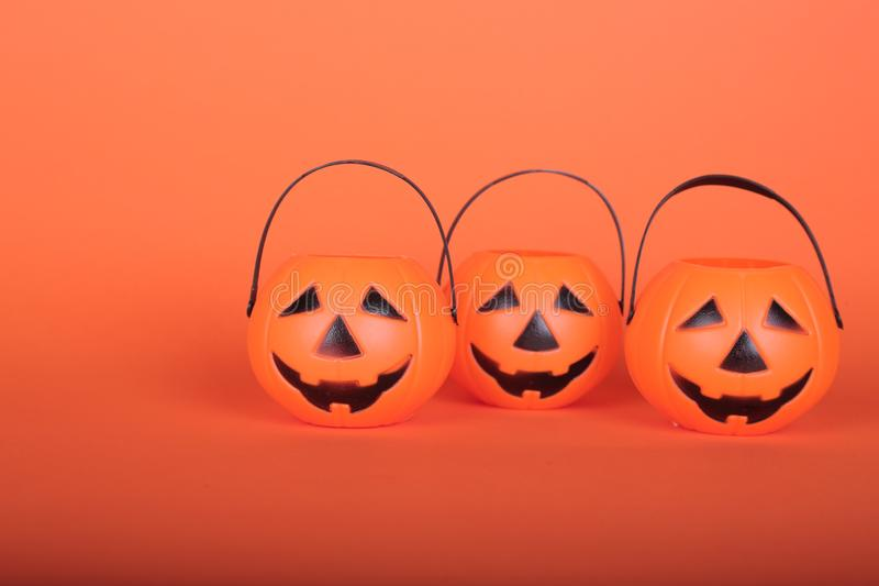 Happy Halloween Trick or Treat jack-o-lantern buckets on orange background. Plastic pumpkins  to collect candy. Happy Halloween Trick or Treat jack-o-lantern stock images