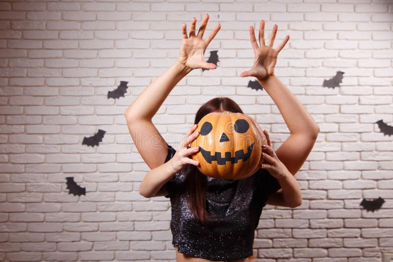 Happy Halloween! Two young cute women with pumpkin head frighten. Somebody over Halloween decorations stock photos