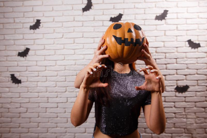 Happy Halloween! Two young cute women with pumpkin head having f. Un over Halloween decorations. Image with copy space stock images