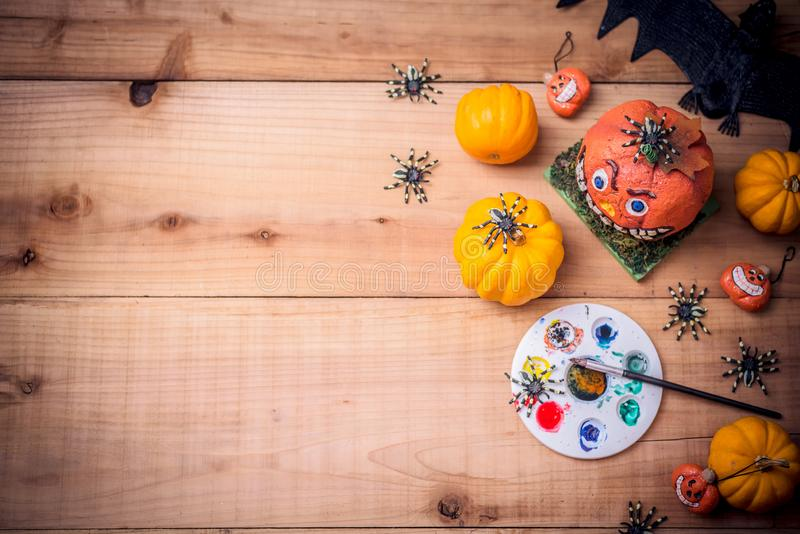 Happy Halloween with painting pumpkin, trick or treat in autumn season. Happy Halloween. Werewolf or zombie hands painting scary pumpkin for trick or treat royalty free stock photos