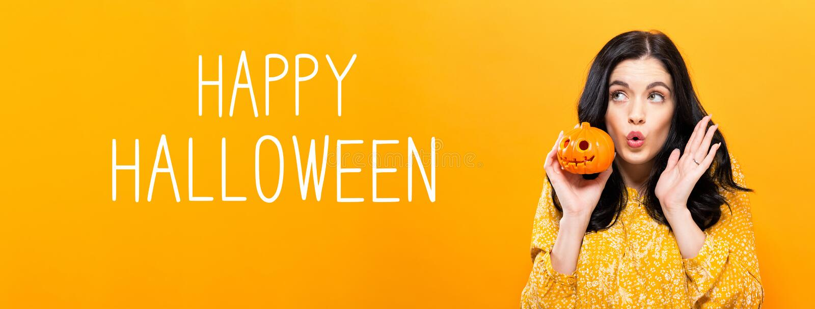 Happy Halloween with woman holding a pumpkin. Happy Halloween with young woman holding a pumpkin stock photos