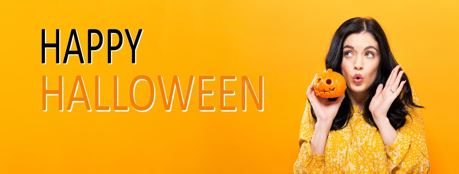 Happy Halloween with woman holding a pumpkin stock photography