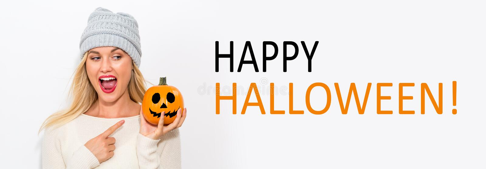 Happy Halloween with woman holding a pumpkin. Happy Halloween with young woman holding a pumpkin royalty free stock photography