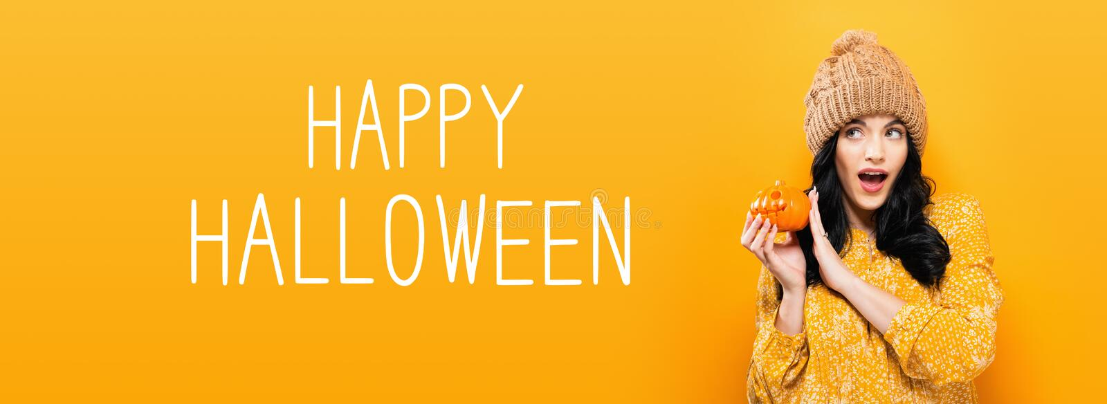 Happy Halloween with woman holding a pumpkin. Happy Halloween with young woman holding a pumpkin royalty free stock photo