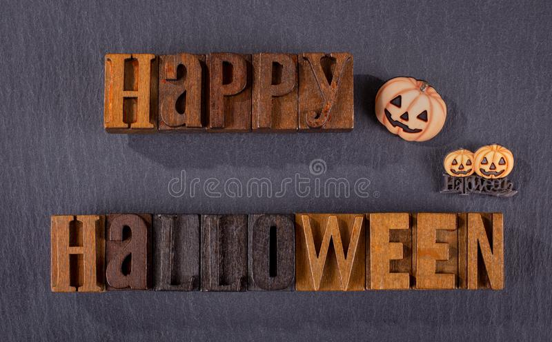 Happy Halloween Wooden Block Text on a Black Background stock photo