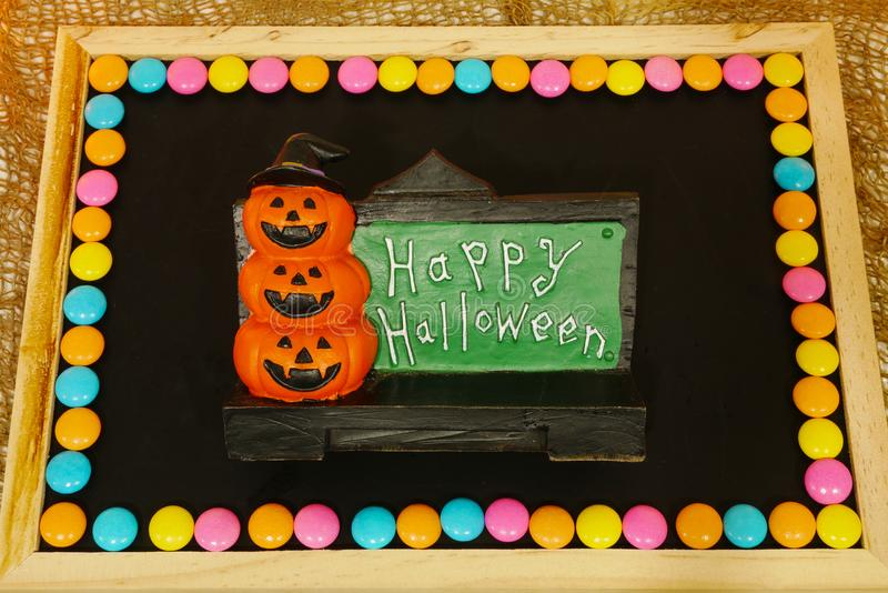 Happy Halloween words decoration with scary pumpkin background royalty free stock photo