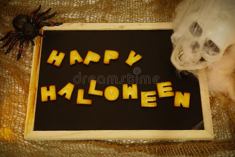 Happy Halloween words decoration with skull background stock photography