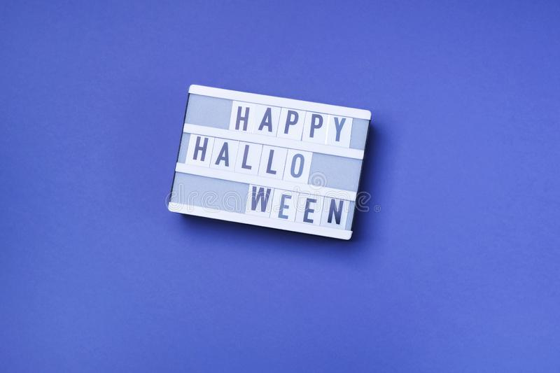 Happy Halloween words written on white board. Halloween lettering, lot of free space royalty free stock photos