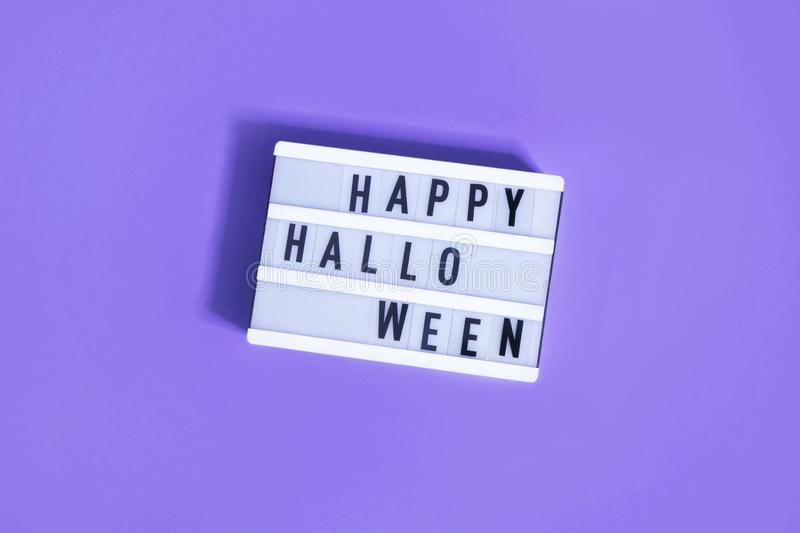 Happy Halloween words written on white board. Halloween lettering, lot of free space royalty free stock images