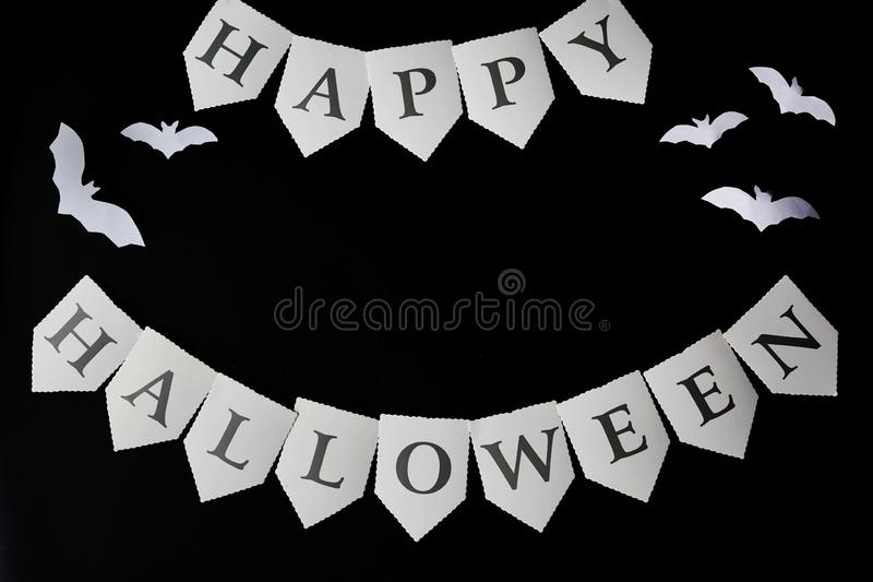 Happy Halloween written on black Background with bats, copy space.  stock images