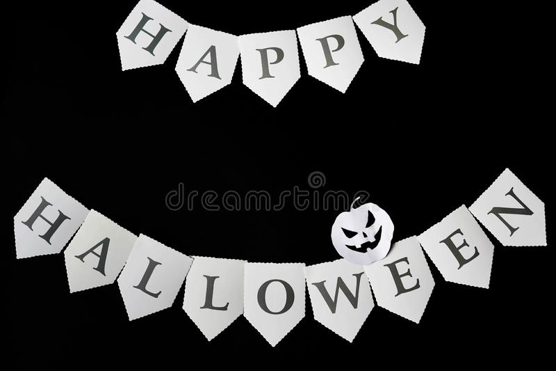 Happy Halloween written on black Background with pumpkin, copy space.  stock photo