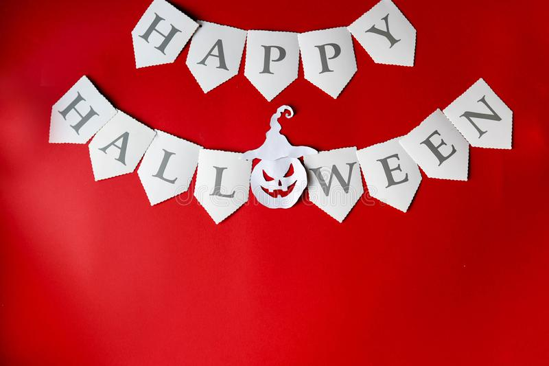 Happy Halloween written on red Background with pumpkin, copy space.  royalty free stock photography