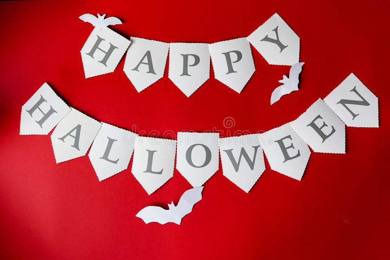 Happy Halloween written on red Background with bats. Happy Halloween written on red dark Background with bats royalty free stock photography