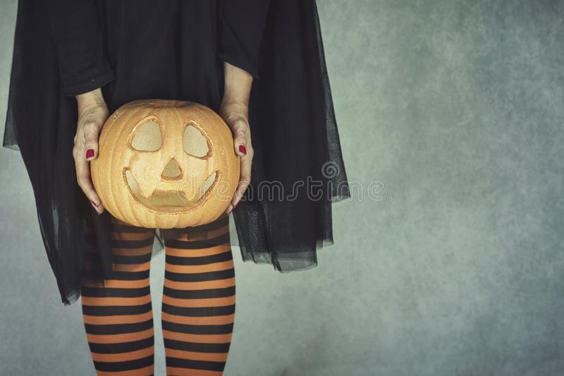 Happy halloween, Young woman holding a pumpkin in halloween stock images