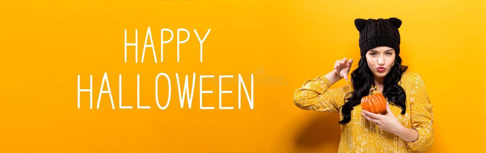 Happy Halloween with woman holding a pumpkin. Happy Halloween with young woman holding a pumpkin royalty free stock image