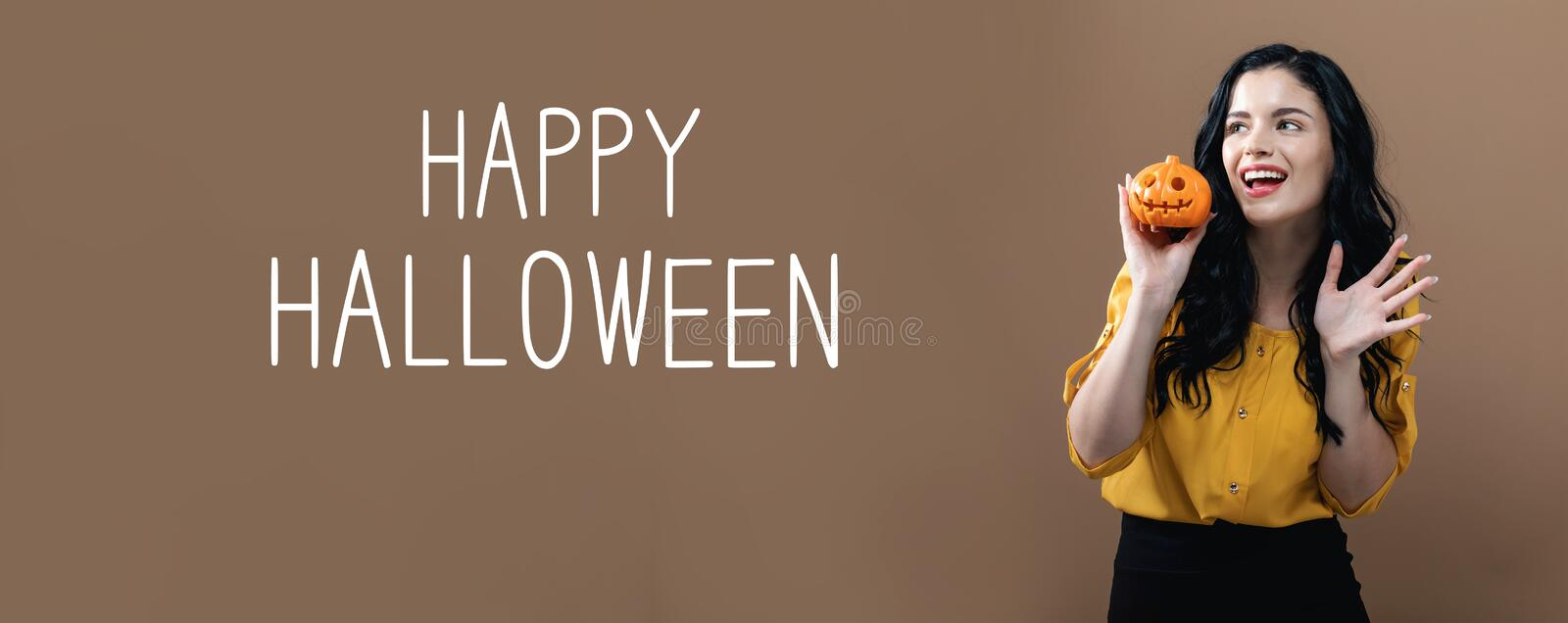 Happy Halloween with woman holding a pumpkin. Happy Halloween with young woman holding a pumpkin royalty free stock photos