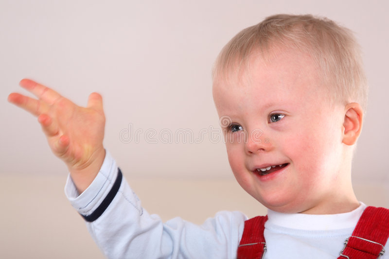 Happy handicapped boy royalty free stock images