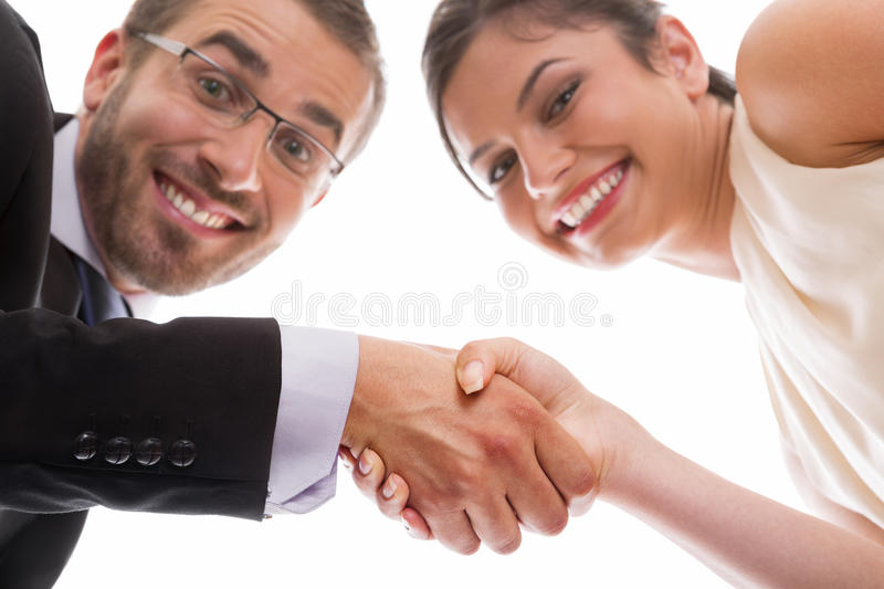 Happy handshake and teamwork. Happy and smiling businesswoman ans businessman handshaking over successful deal stock photos