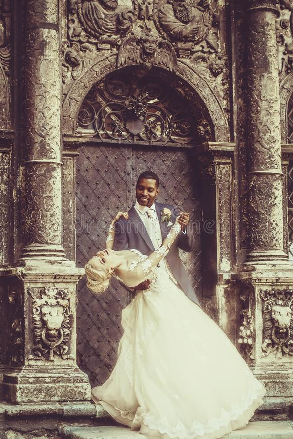 Happy handsome african groom and cute bride smiling royalty free stock photo