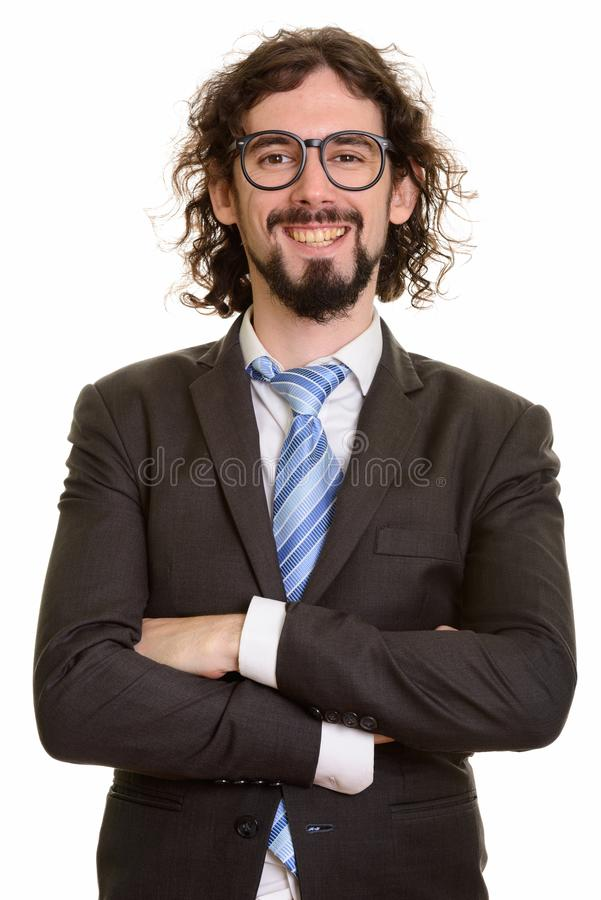 Happy handsome Caucasian businessman smiling with arms crossed royalty free stock photo