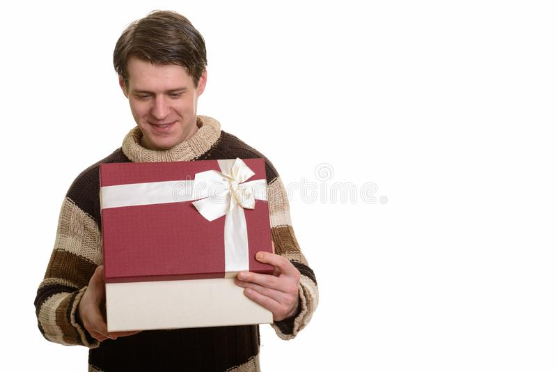 Happy handsome Caucasian man opening gift box ready for Valentin. E`s day stock photography