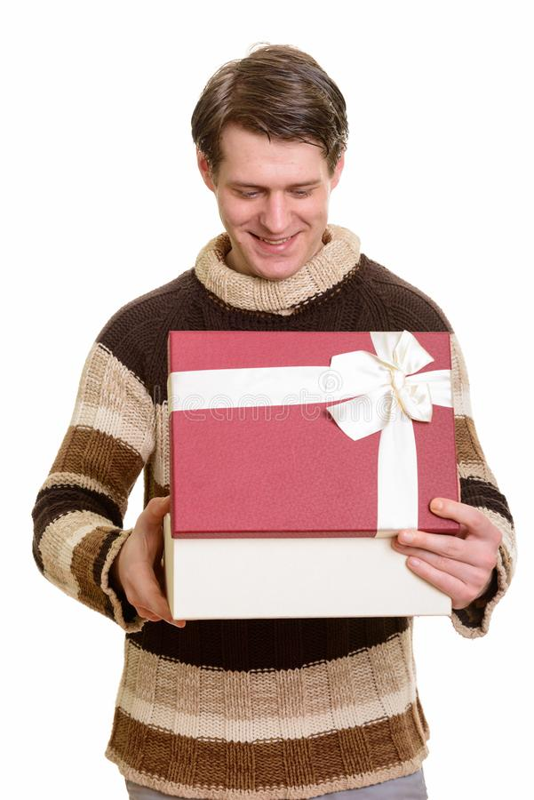 Happy handsome Caucasian man opening gift box ready for Valentin. E`s day stock photo