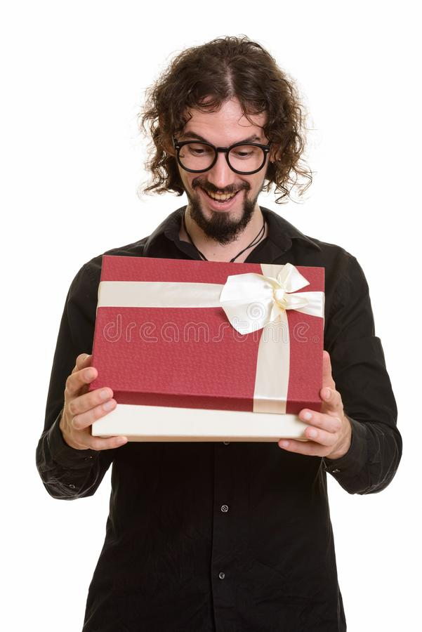 Happy handsome Caucasian man opening gift box ready for Valentin. E`s day royalty free stock images