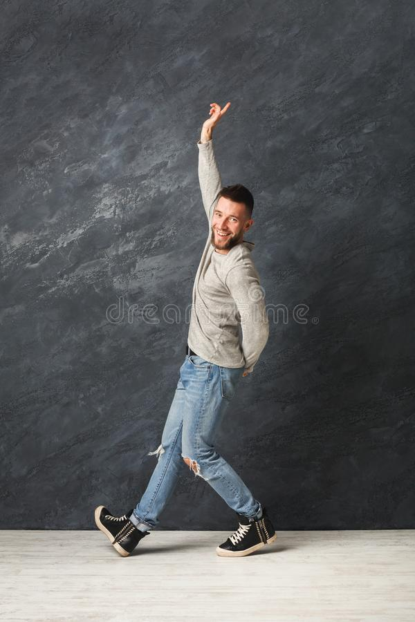 Happy handsome man dancing in studio royalty free stock photography