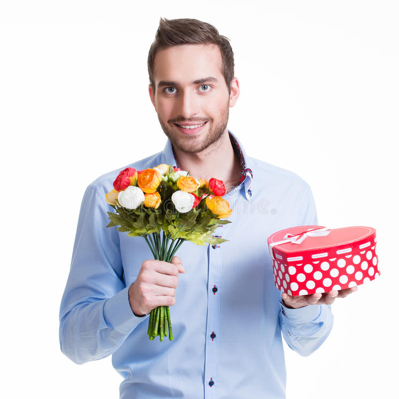 Happy handsome man with flowers a gift. stock images