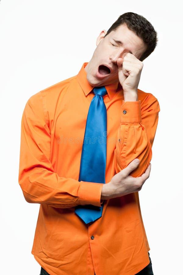 Happy handsome man in orange shirt. royalty free stock image