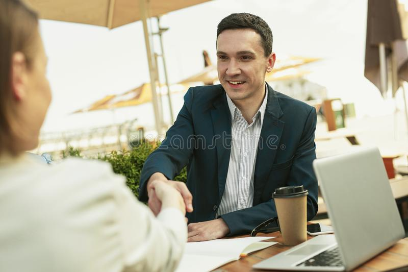 Happy handsome man smiling while making good deal. Good deal. Happy handsome men smiling and drinking tasty coffee while making good deal for company stock photo
