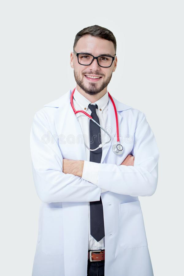 Happy Handsome smiling medical young doctor with stethoscope on stock photo
