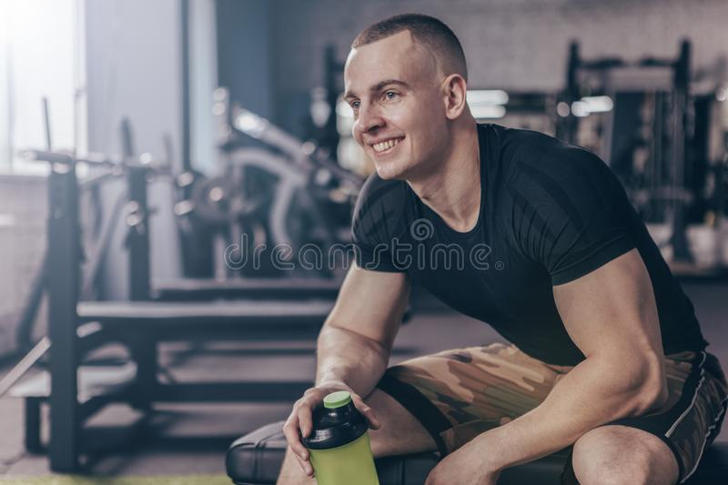 Cheerful man relaxing after workout at the gym stock photos