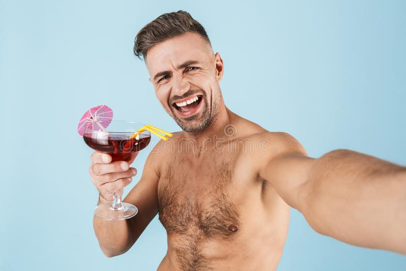 Happy handsome young shirtless man royalty free stock images