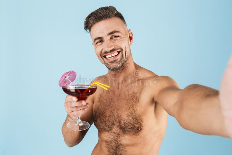Happy handsome young shirtless man stock photography