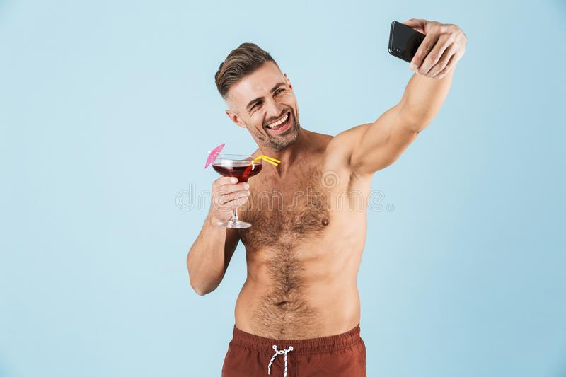 Happy handsome young shirtless man stock images