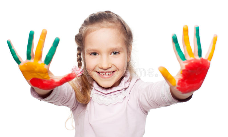 Happy happy girl with painted palms royalty free stock image