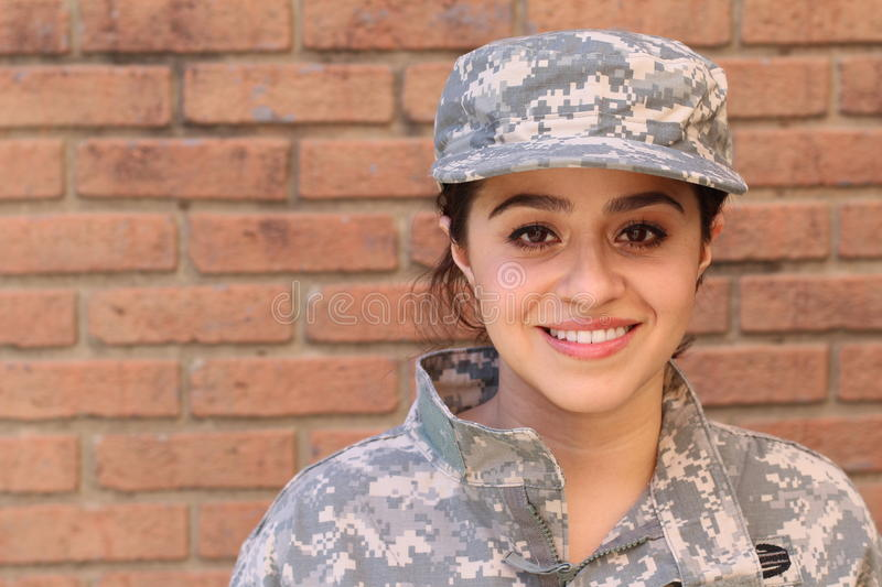 Happy healthy ethnic army female soldier stock images