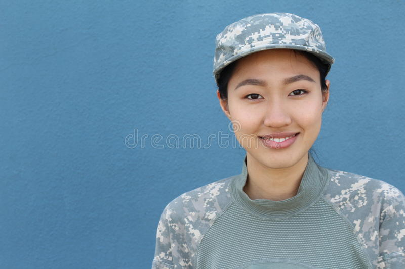 Happy healthy ethnic army female soldier with copy space on the left royalty free stock images