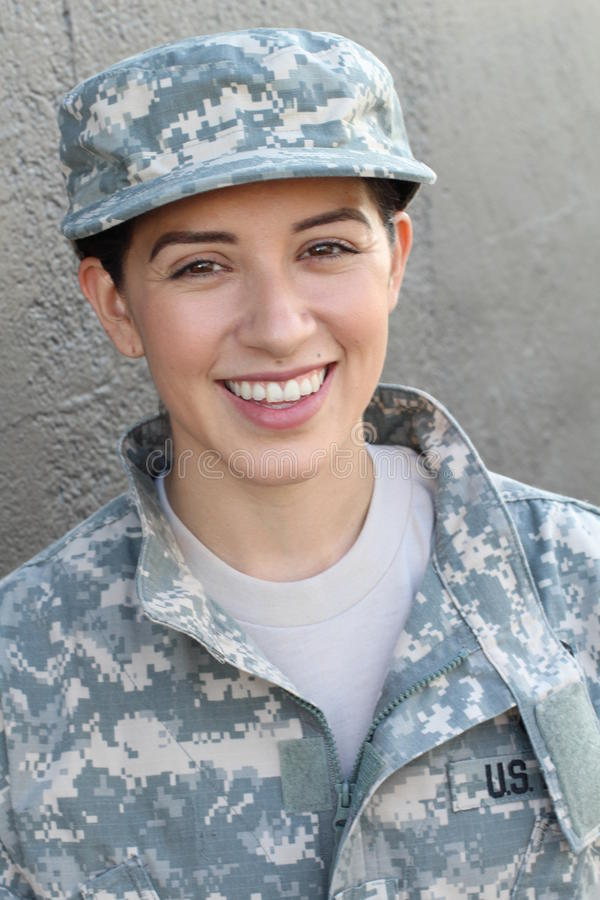 Happy healthy ethnic army female soldier smiling and laughing showing pride and joy royalty free stock image