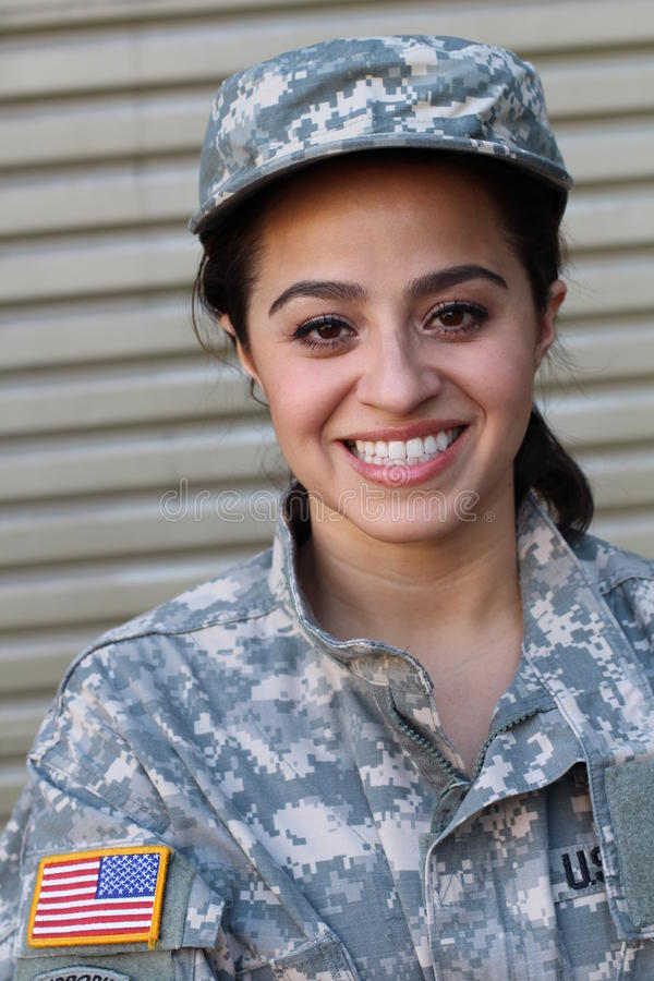 Happy healthy ethnic female army soldier stock images