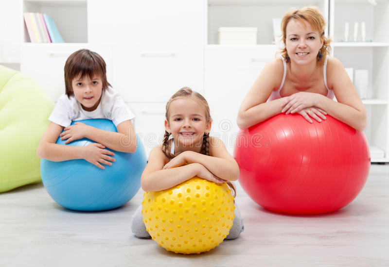 Happy healthy family relaxing in the middle of gymnastic exercise stock image